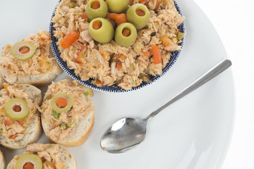 bread with tuna salad topping and olives