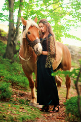 sexy girl elf in the mountains with a horse
