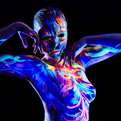 Pretty girl with luminescent body art, close-up