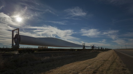 4K Time lapse windmill blades on cargo train with highway