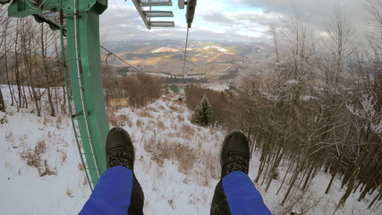 4k, Man goes to the ski lifts and dangled his legs