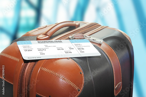 suitcase and boarding pass at the airport - 78098433