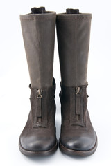 Women's brown leather boots with low heels..