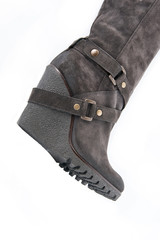 Women's brown suede boots with high wedges (part)..