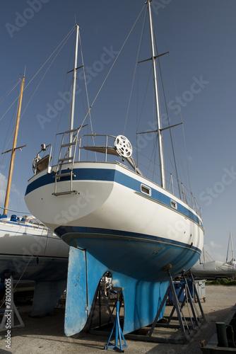 Leinwandbild Motiv blue boat on dock for maintaines