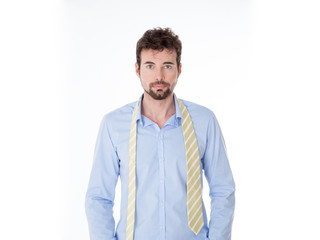 young man with disorderly yellow tie