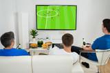 Three Men Watching Football Match