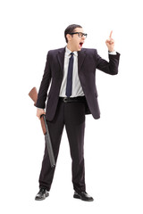 Businessman holding a rifle and gesturing with finger