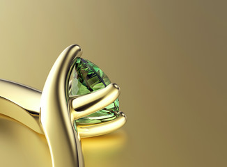 Golden Ring with emerald. Jewelry background