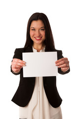 Beautiful asian business woman pointing into copy space - sales