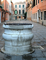 marble well in calle of Venice in Italy