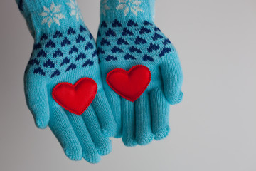Read hearts in hands in warm gloves for Valentine's Day