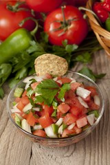 bowl of mexican salsa with chips