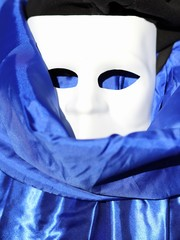 white mask and blue dress in venice