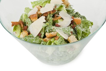 caesar salad on a glass bowl