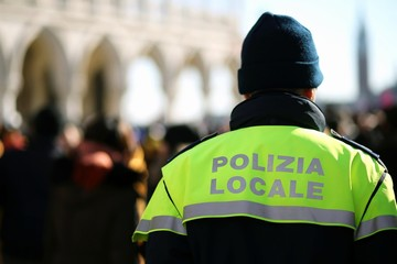 Italian policeman with police uniform patrol in venice