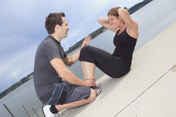 A couple athletes training outside for marathon.