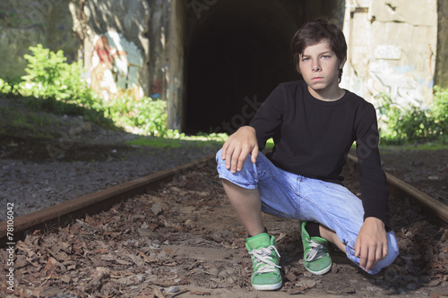 A young boy posing at the railroad - 78106042