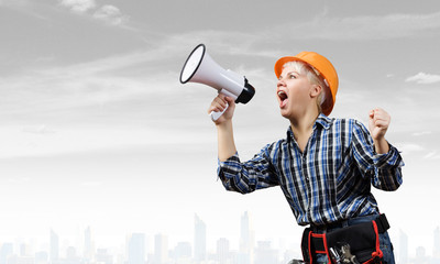 Woman builder with megaphone