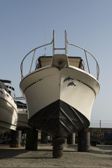 white boat on repairing dock