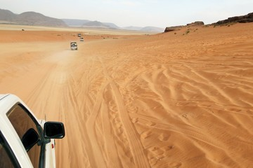 tourists in search of adventures in the desert of Jordan
