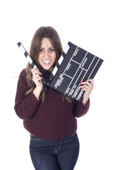 Young woman holding a clapboard