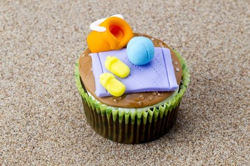 cupcake in the sand with miniature toppings