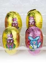 easter eggs wrapped in pink and yellow foil