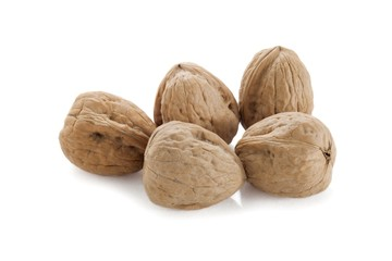 five walnuts on a white background