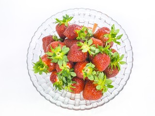 fresh whole strawberries glass plate