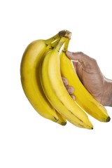 human hand holding bunch of banana