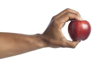human hand holding red apple