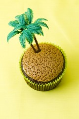 image of a cupcake with plastic coconut tree miniatures