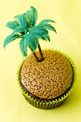 image of cupcake with plastic coconut tree