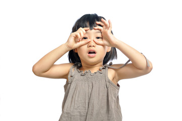 Asian little girl looking through imaginary binocular isolated o