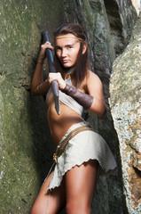 Primitive woman  holding a spear. Amazon woman