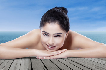 Beautiful model with clean skin at beach