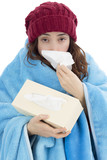 Shivering flu woman sneezing at a tissue