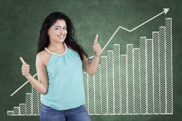 Casual woman with thumbs up and chart
