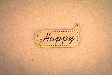 happy word tag on brown paper background