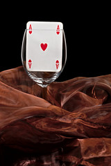 Playing card in the glass