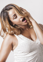 Sensual and tired woman yawning