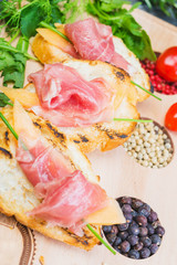 traditional Spanish tapas with slices of hamon and melon on a