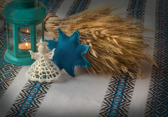 Christmas background with angel lantern and Didukh (diduch)