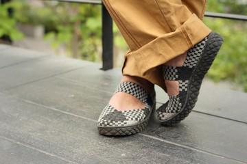 Women wear black shoes at the park
