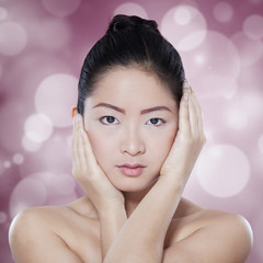 Gorgeous chinese woman on bokeh background