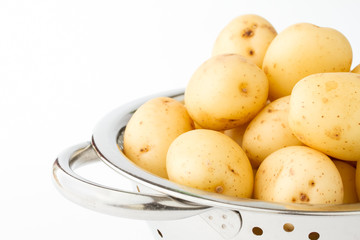 New potatoes in a stainless steel colander