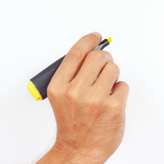 Hand holding a marker on a white background
