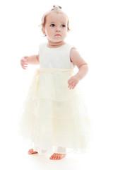 Cute little girl in a white dress