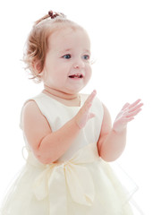 Cute cheerful little girl claps her hands.
